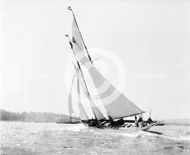 The schooner 'Flying Foam' sailing close-hauled in a good wind, 1910.  Creator: Kirk & Sons of Cowes.