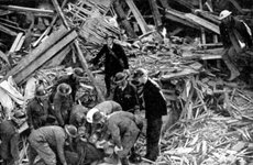 Thumbnail image of Rescue workers releasing a man from a bomb damaged building, World War II, 1940. Artist: Unknown