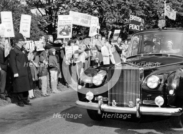 The Queen arrives at Chequers, ignoring protest banners about the Vietnam War, 1970. Artist: Unknown