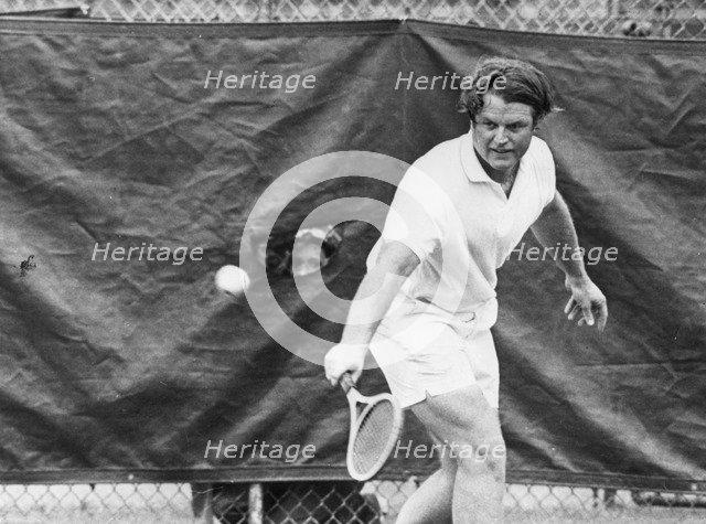 Senator Edward Kennedy (b1932) playing tennis, c1970s. Artist: Unknown