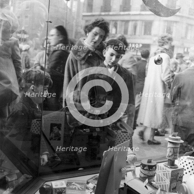 Christmas shoppers outside a toyshop, London, 1957. Artist: Henry Grant