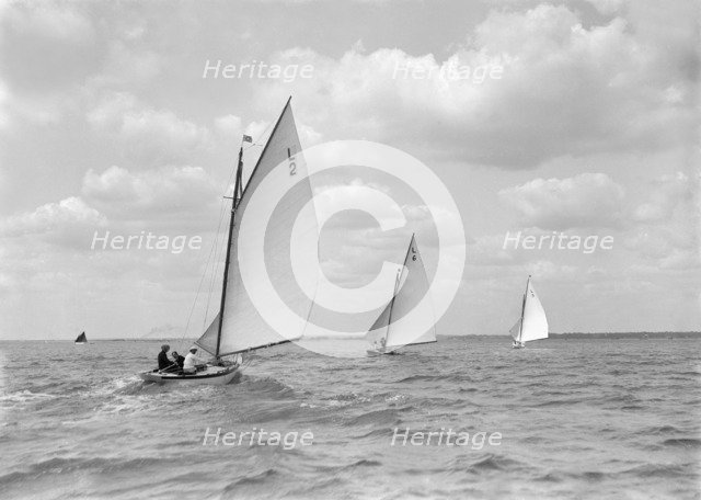 The 6 Metre 'Correnzia', 'The Whim' and 'Snowdrop' on a run, 1911. Creator: Kirk & Sons of Cowes.