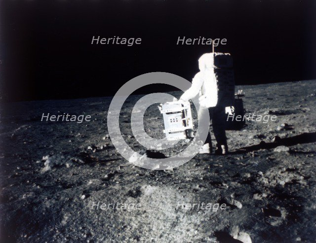 Buzz Aldrin carries out an experiment on the lunar surface, Apollo II mission, July 1969. Creator: Neil Armstrong.