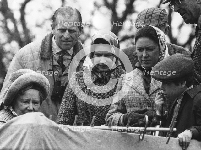 The Royal family watch a portable television at the Badminton Horse Trials, 1973. Artist: Unknown