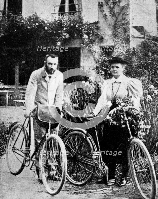 Pierre and Marie Curie, French physicists, preparing to go cycling. Artist: Unknown