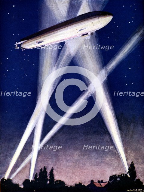 Zeppelin airship caught in searchlights during a bombing raid over England, 1916. Artist: Unknown