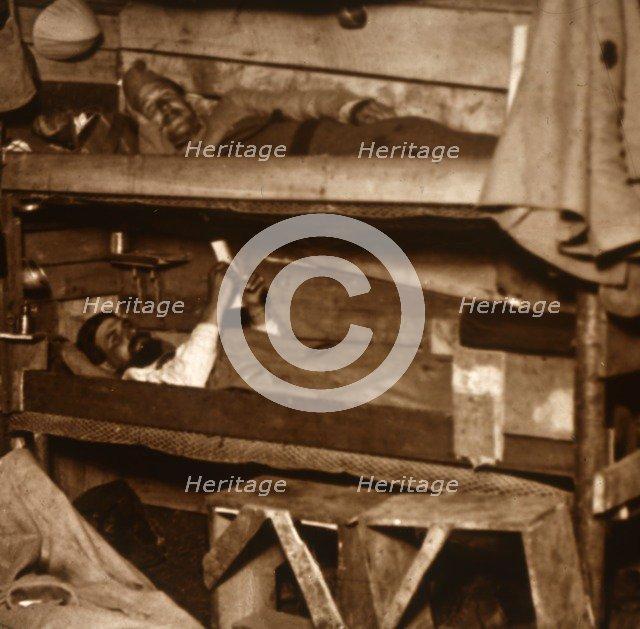 Soldiers in wooden bunks, c1914-c1918. Artist: Unknown.