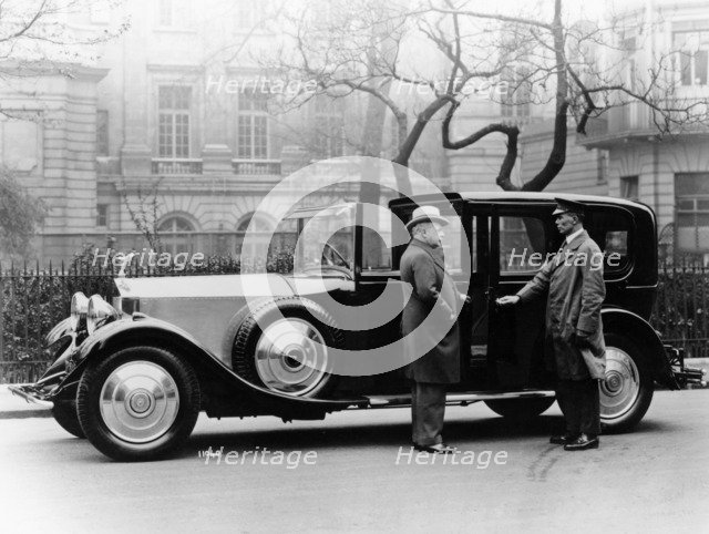 Rolls Royce with chauffeur. Artist: Unknown