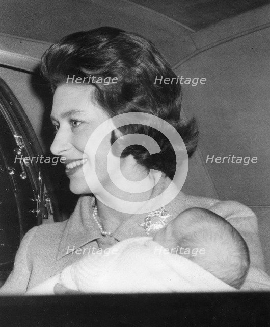 Princess Margaret cradling her new born son Viscount Linley, 1st January 1961. Artist: Unknown