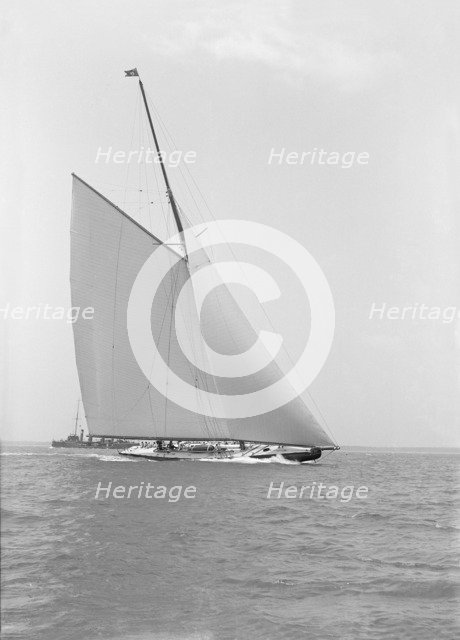 America's Cup challenger 'Shamrock IV' sailing without topsail, 1914. Creator: Kirk & Sons of Cowes.