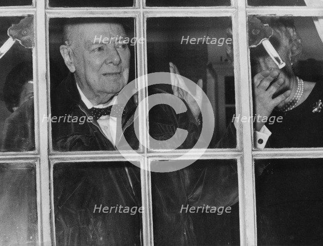 Sir Winston Churchill waving from his Hyde Park Gate window on his 89th birthday, 1963. Artist: Unknown