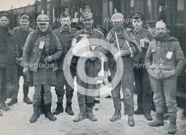 Some cheerful wounded from the Neuve Chapelle fighting, wearing captured German helmets, 1915. Artist: Unknown