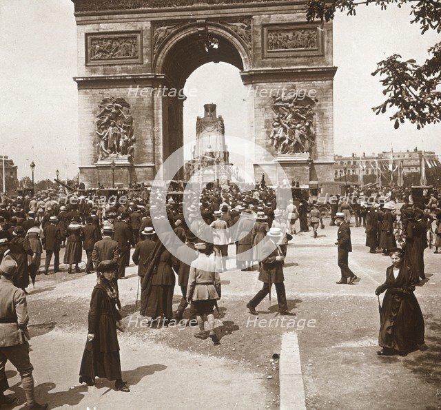 Victory celebration, civilians at the Arc de Triomphe, Paris, France, July 1919.  Artist: Unknown.