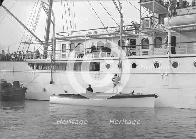 Liberty's motor launch alongside 'Liberty', 1914. Creator: Kirk & Sons of Cowes.