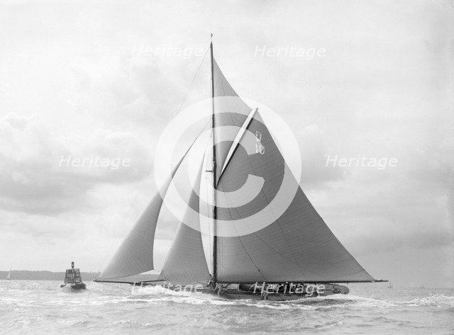'The Lady Anne' spray over deck, sailing close-hauled, 1912. Creator: Kirk & Sons of Cowes.