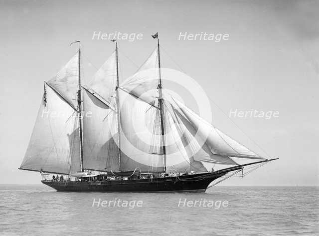 The three-mast auxiliary schooner 'Invincible', 1911. Creator: Kirk & Sons of Cowes.