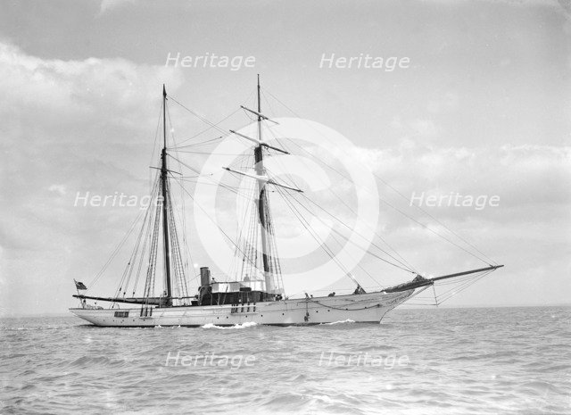 The sailing yacht 'Sea Belle' under way, 1911.  Creator: Kirk & Sons of Cowes.