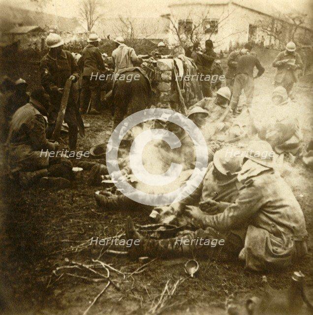 Infantrymen at makeshift kitchen, Cussy farm, Craonne, northern France, c1914-c1918. Artist: Unknown.