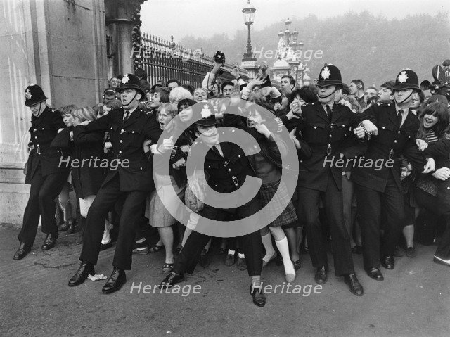 Outside Buckingham Palace when the Beatles received their MBEs, London, 26 October 1965. Artist: Unknown