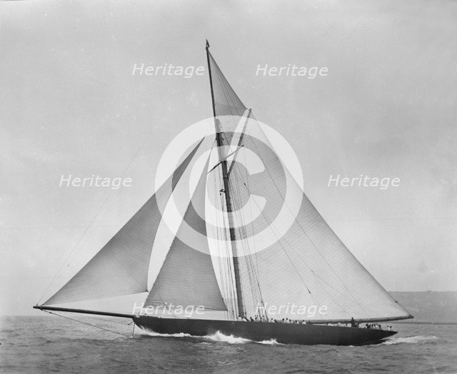 The cutter 'Shamrock' beating to windward. Creator: Kirk & Sons of Cowes.