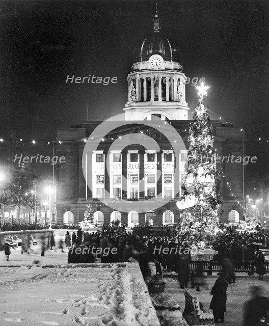 Christmas illuminations in the Market Square, Nottingham, Nottinghamshire, c1950s. Artist: Edgar Lloyd