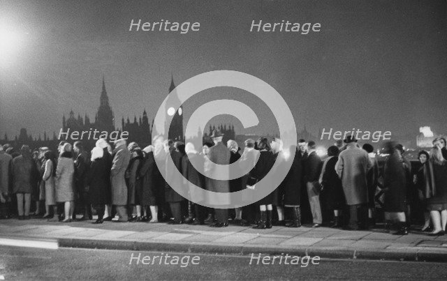 The queue on Lambeth Bridge to pay homage to Winston Churchill at Westminster Hall, 1965. Artist: Unknown
