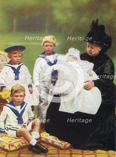 Queen Victoria (1819-1901) pictured with some of her great-grandchildren, at Osborne House on the Is Artist: Unknown