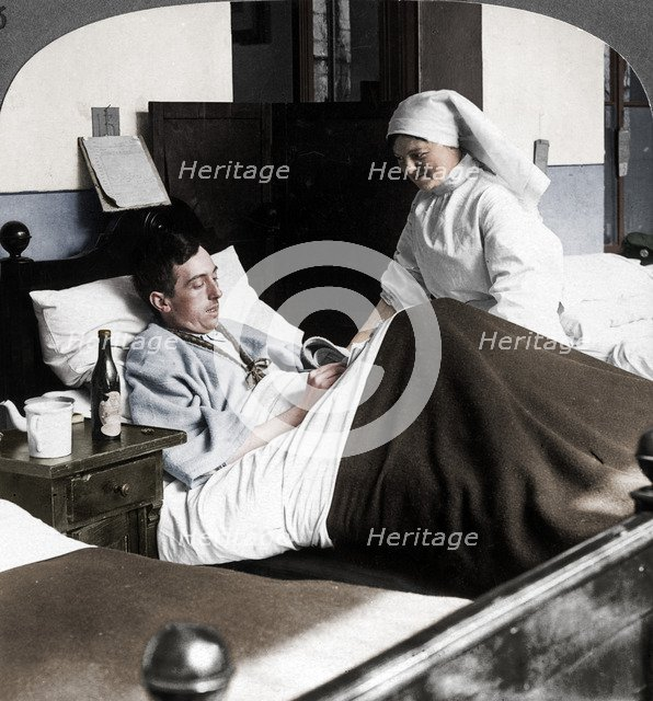 A soldier writing a letter in hospital, World War I, 1914-1918. Artist: Realistic Travels Publishers.