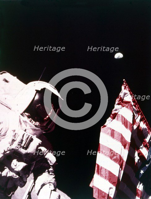 Harrison Schmitt with US flag on the surface of the Moon, Apollo 17 mission, December 1972. Creator: Eugene Cernan.