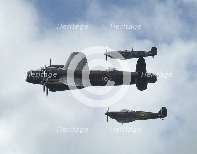 2011 Goodwood Revival Meeting, Lancaster bomber and 2 Spitfires in aerial display. Artist: Unknown.