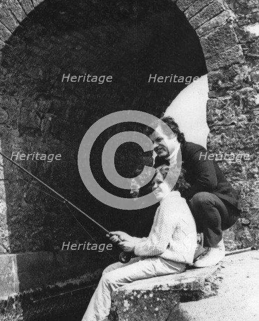 Senator Edward Kennedy with his son Edward Jr fishing in Galway, Ireland, 1974. Artist: Unknown
