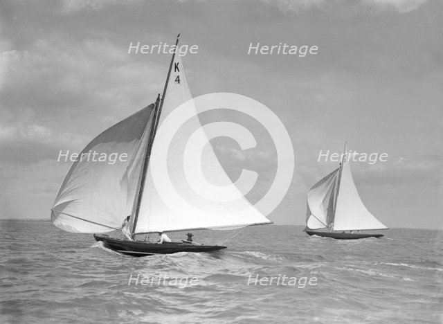 The 7 Metre 'Anitra' (foreground) and 'Nelta', on downwind leg, 1911. Creator: Kirk & Sons of Cowes.