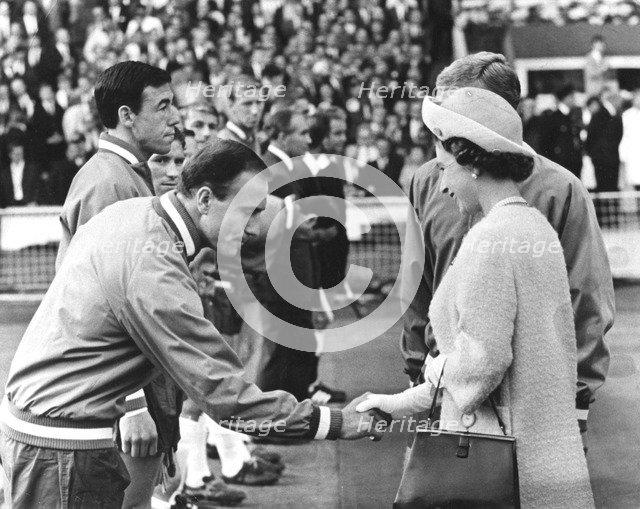 Queen Elizabeth II shaking hands with England footballer George Cohen, World Cup, Wembley, 1966. Artist: Unknown