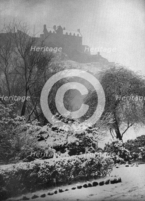 Edinburgh Castle in the snow, from Princes Street Gardens, Scotland, 1924-1926.Artist: W Reid