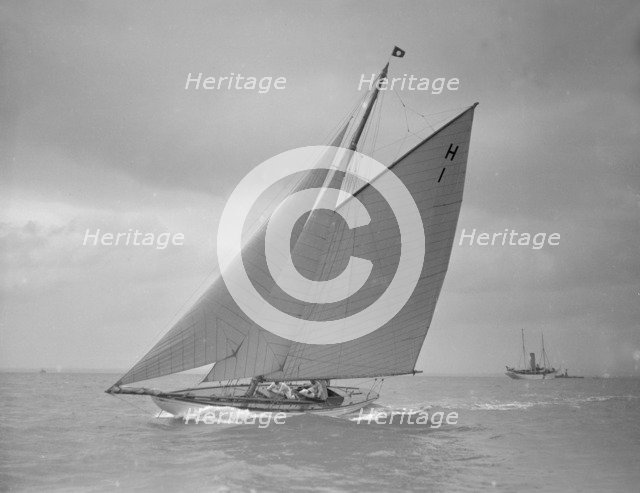 The 8 Metre class yacht 'Norman' (H1) sailing close-hauled, 1911. Creator: Kirk & Sons of Cowes.