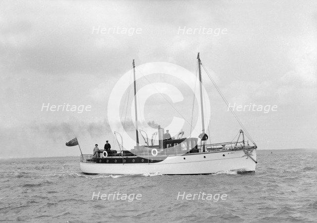 The 23 ton motor yacht 'Kiwi' under way, 1914. Creator: Kirk & Sons of Cowes.