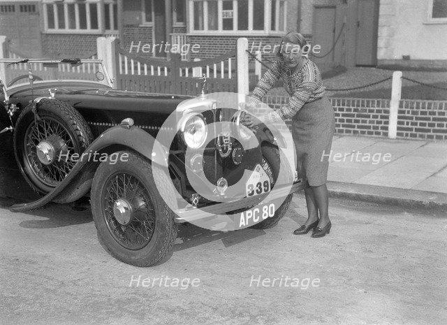 Kitty Brunell and her winning AC 4-seater tourer, RAC Rally, March 1933. Artist: Bill Brunell.