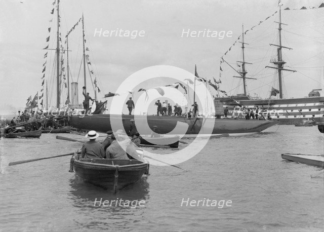 The launch of 'Shamrock IV' with H.M.S. Victory in the background, May 1914. Creator: Kirk & Sons of Cowes.
