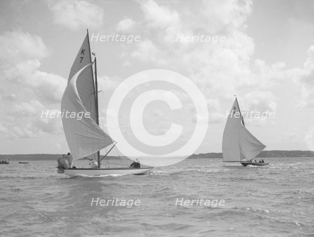The 7 Metre class 'Anitra' (K4) and 'Ginevra' (K7) race downwind, 1912. Creator: Kirk & Sons of Cowes.