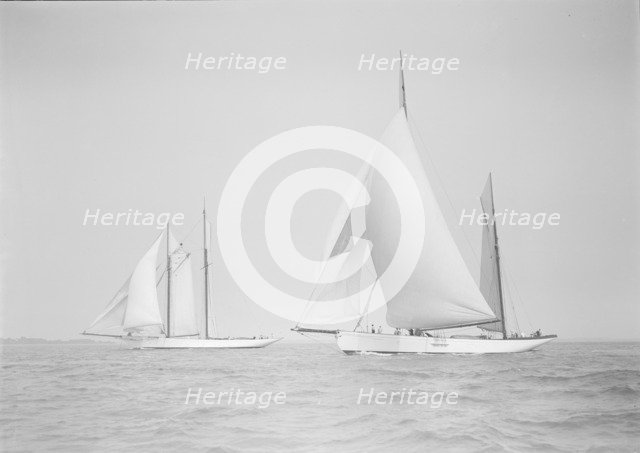 The ketch 'Cariad' and schooner 'Irma' racing downwind, 1911. Creator: Kirk & Sons of Cowes.
