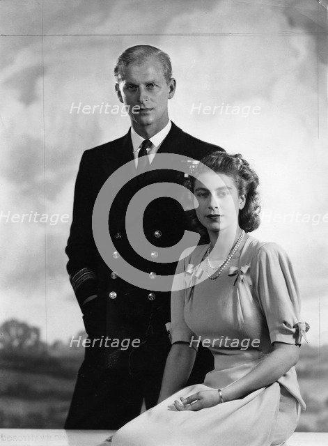 Princess Elizabeth with Lieutenant Philip Mountbatten, 9 July 1947.  Creator: Dorothy Wilding.