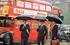Thumbnail image of City gents sheltering under umbrellas in the rain, London, 1965. Artist: Unknown