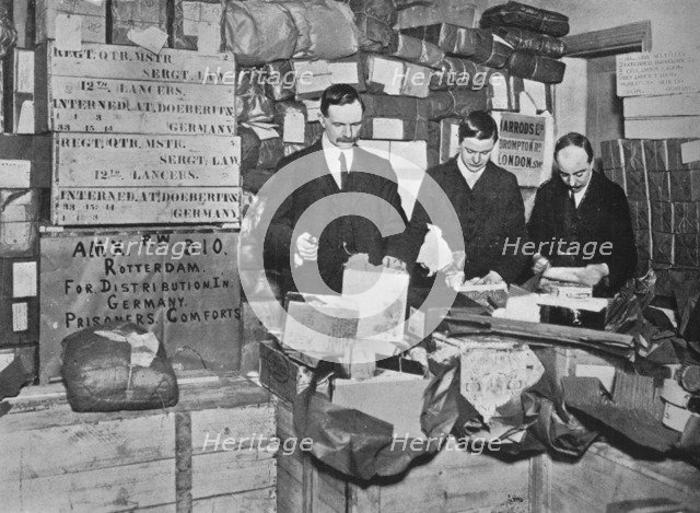 'Packing gifts for despatch to British prisoners in Germany', 1915. Artist: Unknown.