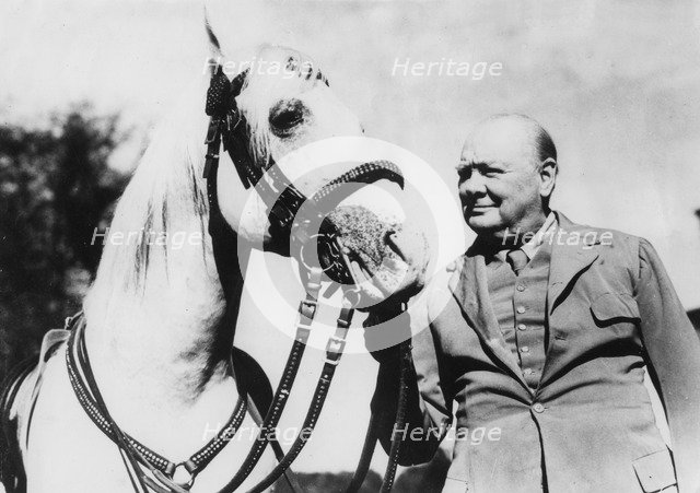 Sir Winston Churchill with one of Bernard Van Leer's circus horses at Chartwell, Kent, 1946 Artist: Unknown.
