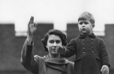 Thumbnail image of Princess Elizabeth and a two year old Prince Charles wave from Buckingham Palace, 1950. Artist: Unknown