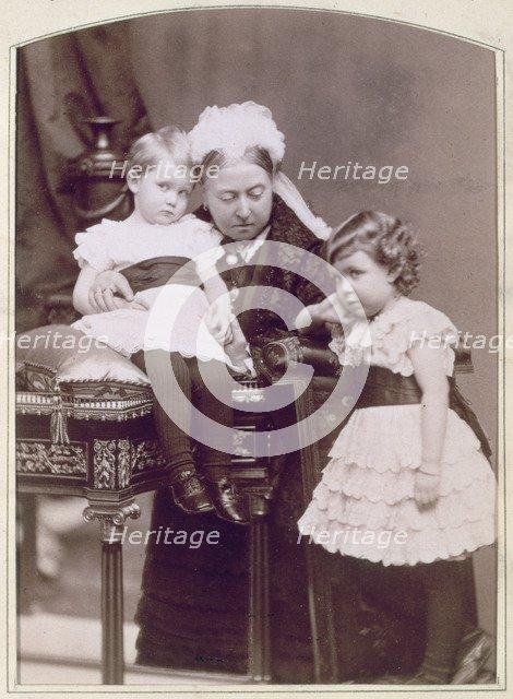 Queen Victoria with two of her grandchildren, April 1886. Artist: Alexander Bassano