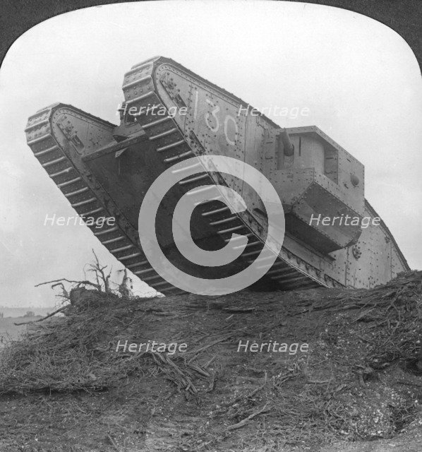 'A tank breaking through the wire at Cambrai', France, World War I, c1917-c1918. Artist: Realistic Travels Publishers