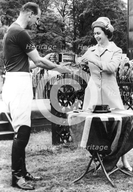 Queen Elizabeth II presents the Duke of Edinburgh with the Horse Show Cup, Windsor Great Park, 1963. Artist: Unknown