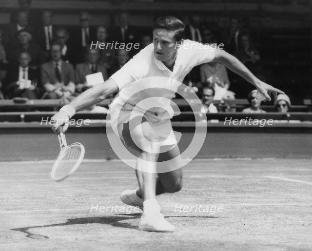 Roy Emerson, Australian tennis player, in action at Wimbledon, 1964. Artist: Unknown