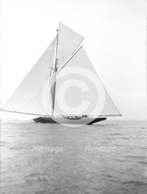 The 221 ton gaff-rigged cutter 'Britannia' sailing under spinnaker, 1913. Creator: Kirk & Sons of Cowes.